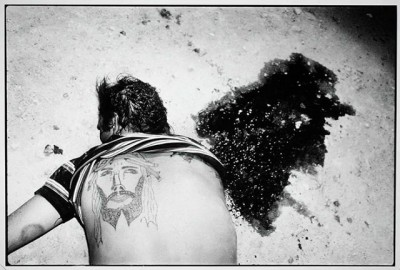 1984, le tatouage du Christ ne l'aura pas protégé. tué par ses collègues