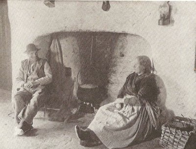 A couple by the fireside in a cottage on Aran