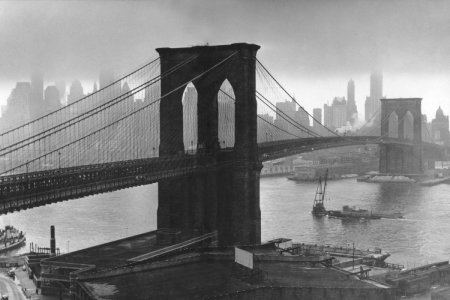 Storm clouds hover over the Brooklyn Bridge and the ghostly skyscrapers of Manhattan's financial district in March 1946