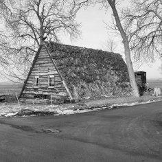 Une photographie historique d'un un-cadre toit de terre maison dans le Pays-Bas. Image - Agence du patrimoine culturel des Pays-Bas