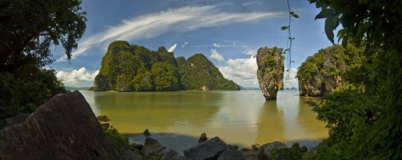 """One of the most famous landmark, the needle-shaped limestone rock jutting out of the sea well known as James Bond Island. Some scenes in the movie """"The Man With the Golden Gun"""" were filmed here. Phang Nga Bay, Thailand"""