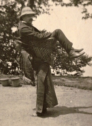 a-british-merchant-being-carried-by-a-sikkimese-lady-on-her-back-west-bengal-circa-1903