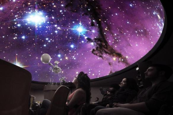 students-watching-stars-in-planetarium