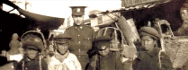 canadian_pte_edwin_stephenson_poses_with_boys_in_vladivostok_in_1919